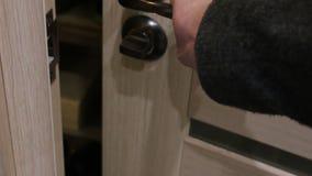 Doorknob turns. The door opens . Turn the door knob stock video footage