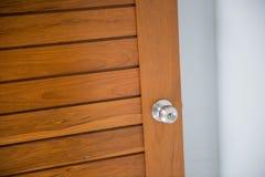 Doorknob on the wood door Royalty Free Stock Photography