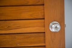 Doorknob on the wood door Royalty Free Stock Photo