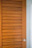 Doorknob on the wood door Stock Images