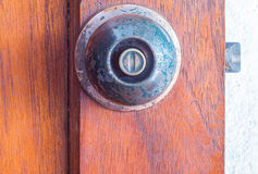 Doorknob. At the wooden door Royalty Free Stock Image