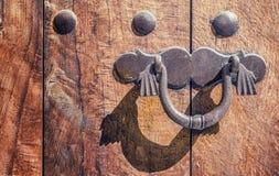 Doorknob on wooden door Stock Image