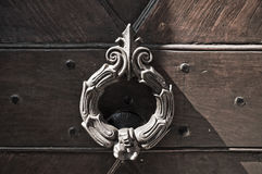 Doorknocker on allwood door. Stock Images
