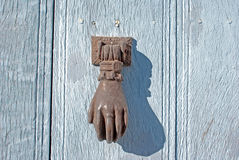 Doorknocker on allwood door Royalty Free Stock Images