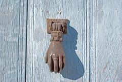 Doorknocker on allwood door Royalty Free Stock Images