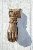 Doorknocker on allwood door Stock Photo