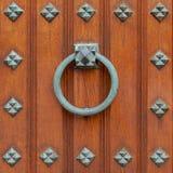 Doorknocker bronze ring on wooden door. Simple large doorknocker bronze ring on wooden door Stock Photography