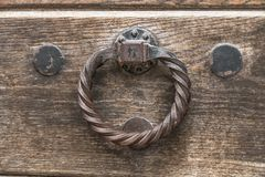 Historical doorknocker. Doorknocker at a castle in austria Royalty Free Stock Photography