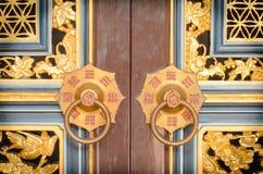 Doorknocker at door front. Doorknocker of chinese style at Phuket Royalty Free Stock Images