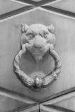 Doorknocker on the front door of the Italian building Royalty Free Stock Images