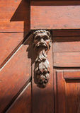 Doorknocker on the front door of the Italian building. Doorknocker on the front door of a old Italian building Stock Photography