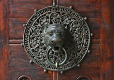 Doorknocker with head of lion. Stock Photos
