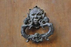 Doorknocker. A doorknocker in iron with fantasy figures Stock Image