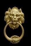 Doorknocker with Lion. Impressive bronze doorknocker with Lion on a black background Royalty Free Stock Photography