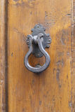 Doorknocker. Old vintage doorknocker in florence Royalty Free Stock Photography