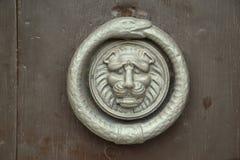 Doorknocker. On a old wood Stock Photo