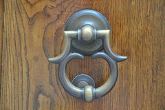 Doorknocker. On a old wood Stock Images