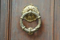 Doorknocker. On a old wood Stock Image