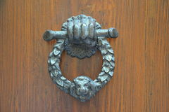 Doorknocker. On a old wood Royalty Free Stock Photo