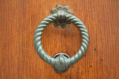 Doorknocker. On a old wood Royalty Free Stock Image
