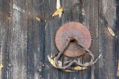Doorknocker. Old doorknocker on wooden door Royalty Free Stock Photography