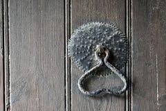 Doorknocker. Old doorknocker on wooden door Royalty Free Stock Image