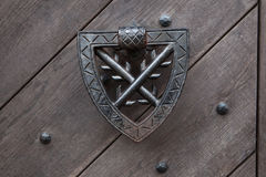 Doorknocker on the wooden gate fixed with rivets Stock Image