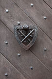Doorknocker on the wooden gate fixed with rivets Royalty Free Stock Image