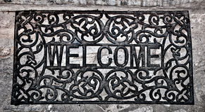 The Doormat curved steel of welcome text Stock Image