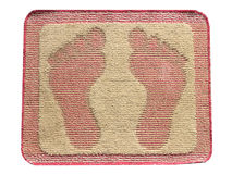 Doormat foot isolate. Stock Photos