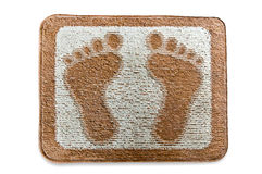 The Doormat of footmark. Isolated on white background Royalty Free Stock Photos