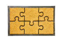 Doormat puzzle Stock Photo