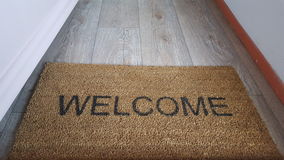 A doormat saying welcome Royalty Free Stock Images