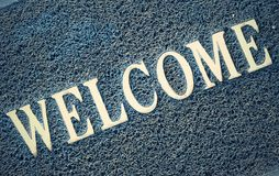 Doormat with welcome text Royalty Free Stock Photo