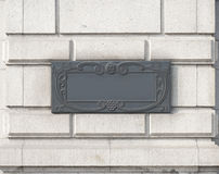 A doorplate on the wall in vintage style. Royalty Free Stock Photos