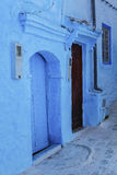 Doors and blue wall of chefchaouen Stock Photos