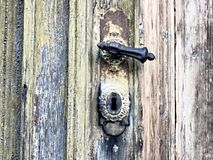 Doors with bolts - rustically. Doors with bolts. Nice old wooden door with rusty bolts in the middle royalty free stock photo