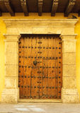 Doors of colonial building in Cartagena, Colombia. Wooden doors of colonial building in Cartagena, Colombia royalty free stock photo