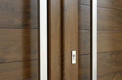 Doors detail. A simple frame with pvc brown door Stock Photo