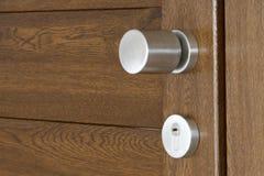 Doors handle. A simple frame with pvc brown door Stock Photos