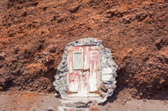 Doors leading into the hill at Red beach Santorini. Island, Greece Royalty Free Stock Photo