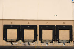 Doors for loading and unloading trailers in warehouse building Stock Photography