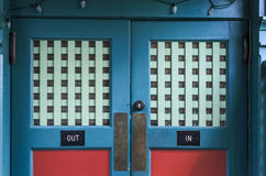 Doors Marked In and Out Stock Photography