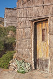 The doors of the old fisherman's house on the beach. Royalty Free Stock Photos