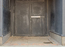Doors from old urban closed out of business store Royalty Free Stock Photos