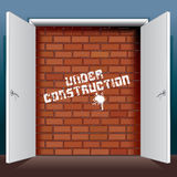 Doors Open to Brick Wall with Under Construction Royalty Free Stock Photo