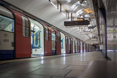 Doors open on Tube train. LONDON, UK - AUGUST 5, 2013: Doors open on a Tube on the Piccadilly Line on the London Undergound royalty free stock photos
