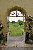 Doors Opening Out Onto an English Country Estate Royalty Free Stock Photography