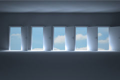 Doors opening in room to show sky Royalty Free Stock Photo