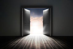 Doors opening to reveal beautiful sky Royalty Free Stock Photo
